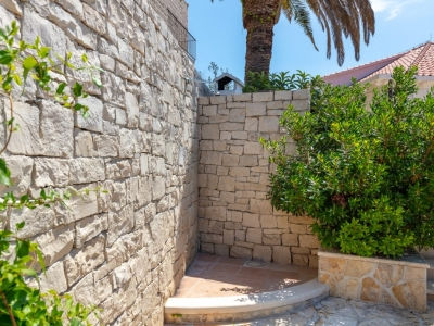 Outdoor shower made of stunning dalmatian stone