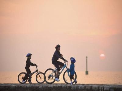 Family bike riding in the Sumartin