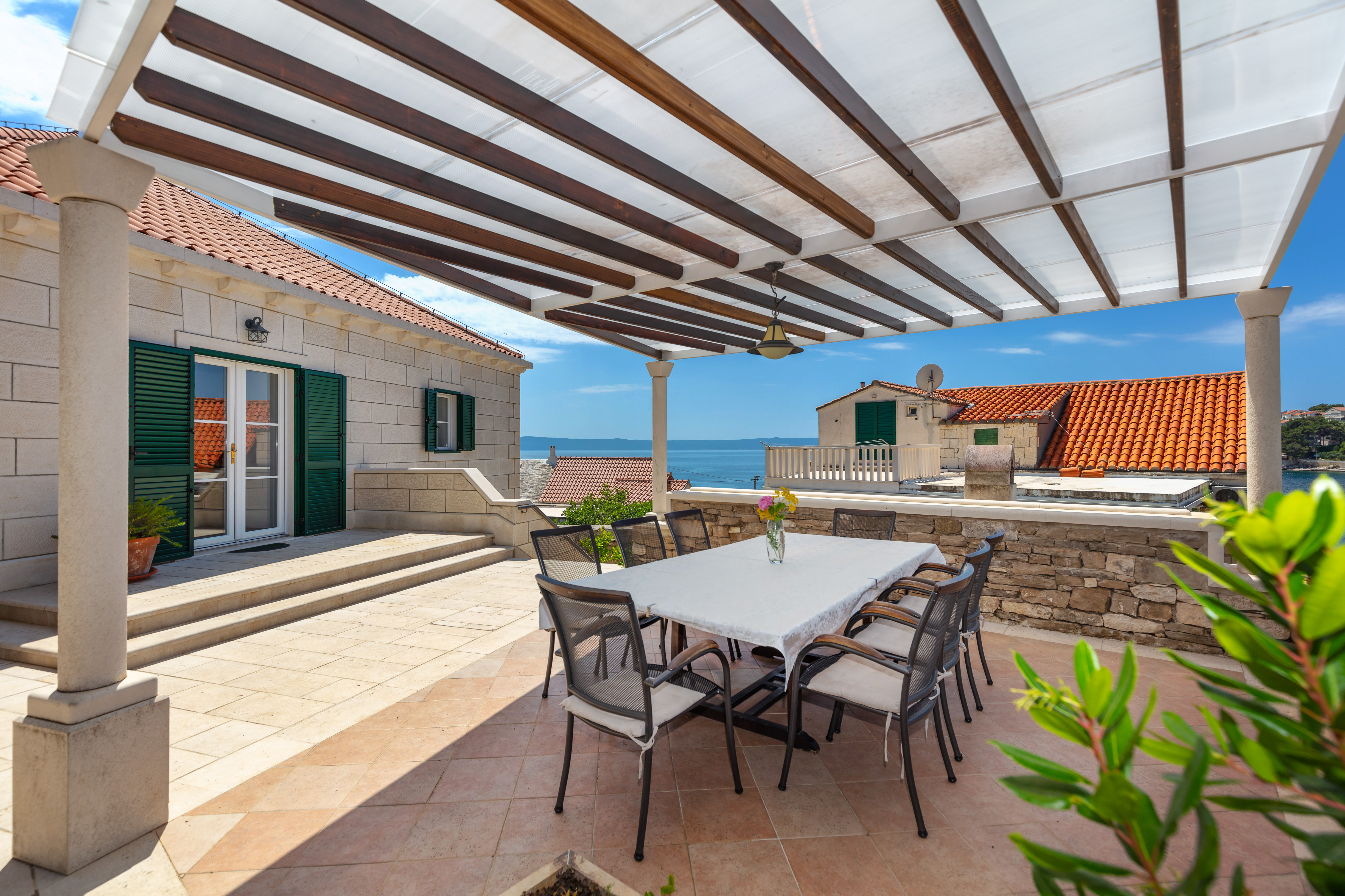 Shaded outdoor dining area with the sea view